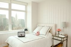Frances Kwon's Apartment. what a serene bedroom!and the view is to die for!