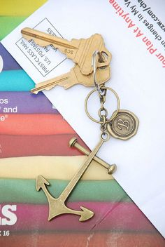 Anchors Away Key Chain Customizable antiqued brass key chain. Pick your monogram to personalize this piece! $6