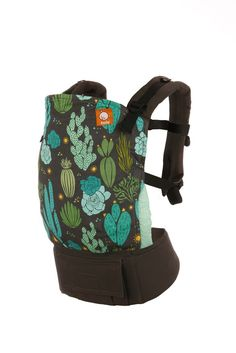 Cacti - Cactus Tula Baby Carrier. Just because it's cold outside doesn't mean we can't hold onto our own little sunshine!! Adorned in desert flora and sunbursts, let's welcome our Tula Baby Carrier: 'Cacti'!
