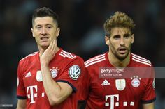 Bayern Munich's Polish forward Robert Lewandowski (L) and Bayern Munich's Spanish defender Juan Bernat react during the German Cup DFB Pokal final football match FC Bayern Munich vs Eintracht Frankfurt at the Olympic Stadium in Berlin on May 19, 2018. (Photo by Christof STACHE / AFP)