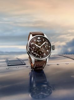 """Discover the IWC Big Pilot's Watch Perpetual Calendar edition """"Antoine de Saint Exupéry"""". The tobacco brown dial and calfskin strap have established themselves as characteristic features of the """"Antoine de Saint Exupéry"""" editions."""