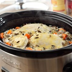 Boneless chicken breasts, carrots and wild rice mix simmer to tenderness in a creamy chicken gravy.
