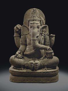 A volcanic stone figure of Ganesha. Indonesia, Central Java, circa 9th century