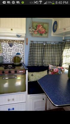 Vintage camper, like the beadboard cabs & blue paint.       Curtains