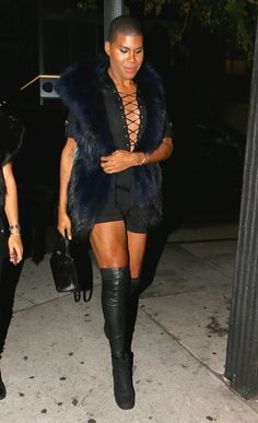 Out and About: EJ Johnson Struts in Faux Fur and a Black Romper