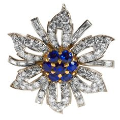 Tiffany & Co. Mid 20th Century Sapphire Diamond Gold Platinum Flower Brooch | From a unique collection of vintage brooches at http://www.1stdibs.com/jewelry/brooches/brooches/