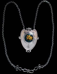 This is not contemporary - image from a gallery of vintage and/or antique objects. NELSON (1859-1942) & EDITH DAWSON  A rare Arts & Crafts silver pendant decorated with a central enamel roundel of  a small flower. Ex. Fine Art Society.