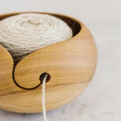 Yarn Bowl by .⠀ To all the wool creatives and yarn artists, this hand made wooden yarn bowl is as eye pleasing as it is helpful keeping your yarn from rolling around. Each bowl is hand made of Birch or Ash wood in Maine. Wood Turning Lathe, Wood Turning Projects, Wood Lathe, Turning Tools, Lathe Projects, Wood Projects, Woodworking Projects, Wooden Yarn Bowl, Wood Bowls
