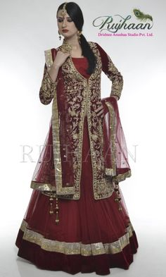 Mehroon sherwani lehenga Mehroon velvet sherwani heavily embellished with golden, silver zarkan and zari work and an outing of cutdana. 3/4th embroidered sleeve on velvet. Red net lehenga finished with lampi and broad velvet border . Small motifs on Red dupatta four side finished with matching lumpi.               http://drishteeanushaa.com/lehengas-page-3.php