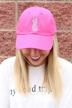 Pineapple twill hat. These adorable caps feature a trendy pineapple design that was hand drawn by a local artist/vendor! A must have for all your Spring/Summer activities! Adjustable back. ALL CLEARAN