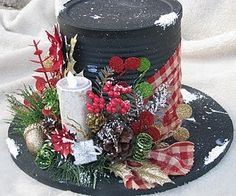 Snowman hat with decoration made out of spraypainted cardboard and coffee can...