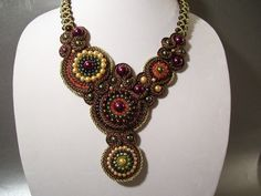 This piece comes from my love of soutache and bead work.    This free form is soutache with 3mm gold and brown soutache cord and rope, 3mm-8mm