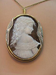 Beautiful Cameo carving, depicting a classical portrait of a young child, Naples Italy