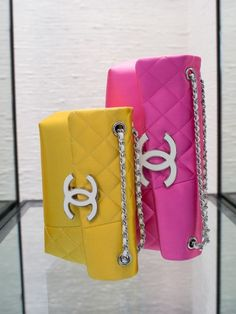 Chanel handbags in yellow & pink