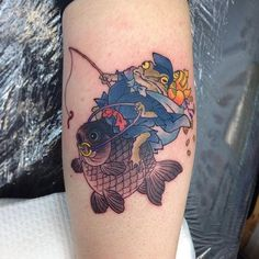 Frog ride a fish tattoo