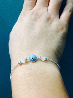 Moonstone evil eye sterling silver bracelet on Etsy, $45.00