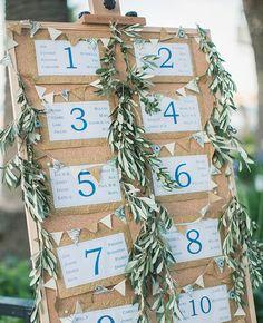 eucalyptus garland escort card display | Anna Roussos | Blog.theknot.com