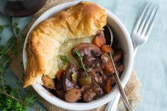 Juicy cremini mushrooms are simmered in a herbed red wine broth and baked up in a flaky puff pastry crust to create this hearty, flavorful vegan pot pie.