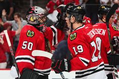 CHICAGO, IL - NOVEMBER 01: Goalie Corey Crawford #50 of the Chicago Blackhawks and Jonathan Toews #19 celebrate after defeating the Calgary Flames 5-1 at the United Center on November 1, 2016 in Chicago, Illinois. (Photo by Chase Agnello-Dean/NHLI via Getty Images)