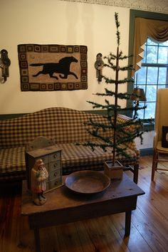 Bellsnickle, feather tree, hooked rug, but need something in that bowl.