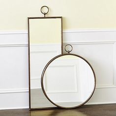 The decorative ring detail crowning our McKenzie Mirror adds a distinctive whimsical touch. The frame is hand crafted of iron and finished in warm gold. McKenzie Mirror features: Hangs from keyholes in backTop ring is purely decorative & not for hanging