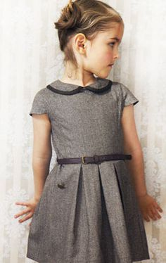 Gray dressy dress, plain bodice, short cap sleeves, Peter Pan collar with black trim, black belt, several soft box pleats in center  - charmer!                                                                                                                                                     More