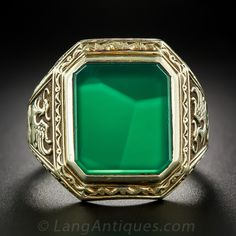 A pair of vigilant griffins perched atop neo-classical columns guard a large and glowing emerald-cut crysoprase in this handsome, rare, large scale and highly-distinctive vintage gent's ring, elegantly crafted in rich 14 karat gold