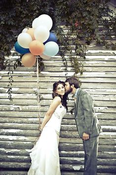 Bride and groom & balloons