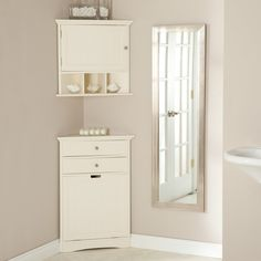corner wall cabinets & hamper - to save space in small bathroom