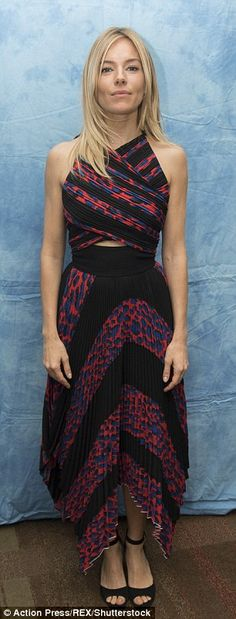 Striking pair:Sienna Miller and her co-star Zoe Saldana were very much modern day fashionistas on Wednesday as they attended a Los Angleles press conference for the forthcoming movie