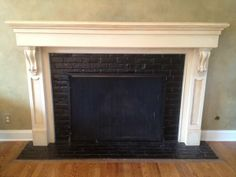 Black tile fireplace, dark paint on top of walls accented with ...