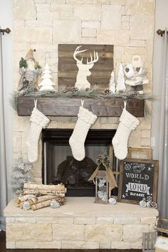 White Christmas Mantel with Pinecones, Stockings and Greenery - 13 Wintry Christmas Fireplace Decorations to Celebrate The Beauty of The Season