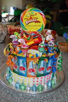 Xavier's favorite food/ thing in the world is CANDY!!!  Aunt Kami feels the same way so created this awesome candy cake for her nephew's 4th!  He LOVES it!!  This cake was the perfect addition to round out Xavier's party-  perfect combo of turtles and candy!!
