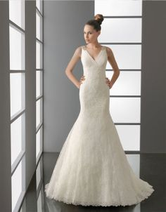 Trumpet/mermaid floor-length lace bridal gown with beading embellishment