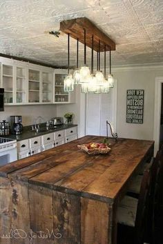 32 Simple Rustic Homemade Kitchen Islands, love this look with white cabinets and rustic light fixture. #homemaderusticfurniture