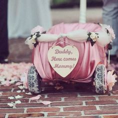 daddy here comes mommy! wedding wagon for child. :)