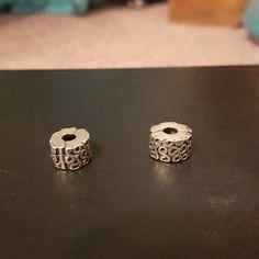 Two Pandora stoppers Great condition, worn few times Pandora Jewelry Bracelets