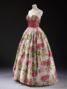 ~Evening dress        Place of origin:        Paris, France (made)      Date:        1957 (made)      Artist/Maker:        Pierre Balmain, born 1914 - died 1982 (designer)      Materials and Techniques:        Printed silk, pleated and boned, with appliqué decoration, net and nylon~