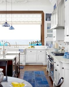 Between the ceiling and the lake view, we're ready to move in. (: @francescolagnese | Design: Martin Horner) #HBloveskitchens #blueandwhite #kitchendesign