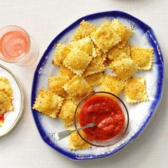 "Toasted Ravioli Puffs Recipe- Recipes I call toasted ravioli a ""fan favorite"" because it disappears faster than I can make it. With just five ingredients, this is how you start the party.Kathy Morgan, Temecula, CA Appetizer Dips, Yummy Appetizers, Appetizers For Party, Appetizer Recipes, Light Appetizers, Homemade Ravioli, Homemade Marinara, Ravioli Recipe, Nachos"