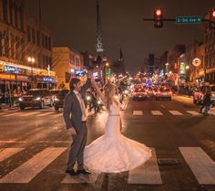 Nighttime street portrait of bride and groom. View more from this urban fall wedding in Nashville with purple and orange details captured by @ZHPhotography! Bridal party attire by @usabridal1 | The Pink Bride® www.thepinkbride.com