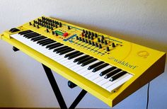 Yellow WALDORF Q: virtual analog synth with 58 knobs for precision tweaking and 8 built-in FX.
