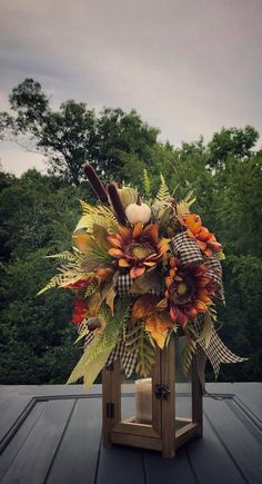 #falldecorating #thanksgiving #arrangement #sunflowers #decoratio #lantern #lantern #floral #autumn #decor #fall #swag #homeFall Lantern Swag, Thanksgiving Home Decor, Lantern Floral Arrangement, Sunflowers, Autumn Decoratio