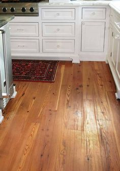 a heart pine floor from goodwin includes boards with the repeating cathedral grain characteristic - Distressed Pine Flooring