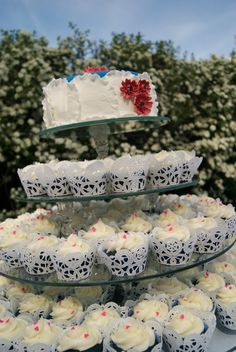 Cupcake Cake Wedding Cake - 100 cupcakes and an 8 inch cake.  Custom made glass stand done by a friend that owns a glass company.  Cake and cupcakes were blue velvet to match the wedding colors.