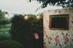 love this floral photobooth wall made by the bride's parents! // photo by JonasPeterson.com