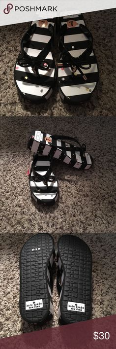 Cute Kate Spade Flip Flops Size 7 Super cute flip flops, never worn!  Black and white with the signature bow on top. kate spade Shoes Sandals