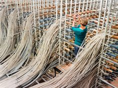 Creel with tubes filled with woolen yarns for a carpet loom, Bloomsburg Carpet Industries - Fruits of the Loom - NYTimes.com