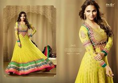OFM-OMLARA-605 Ethnic Yellow Long Anarkali with Raw Silk Yoke, Georgette & Net Kameez with santoon Bottom & inner. Heavy Thread, Jari and Stone Work with combination of Green and Pink color makes it more beautiful. Chiffon dupatta included.