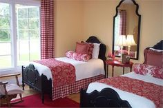 Guest room with twin beds. Love the red check
